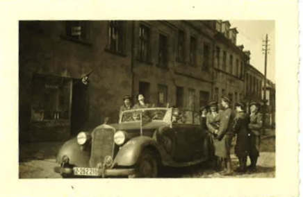 "Eva in Posen 1941.  We asked her where the military got such beautiful cars.  She replied, ""They stole them from people."""