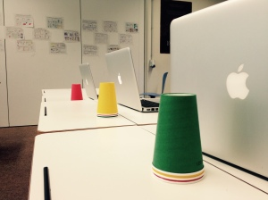 Colored cups and laptops as my students complete their 5 paragraph essays.